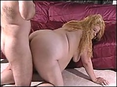 Large blonde lady gives her boyfriend deep blowjob action